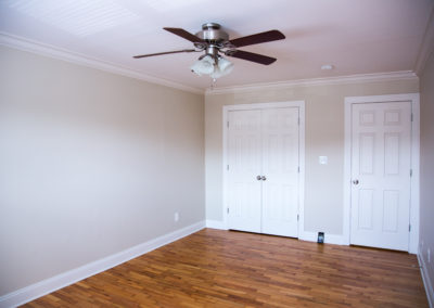 Spacious bedroom with ceiling fan, large closet, and hardwood floors at apartment for rent in Rockland County